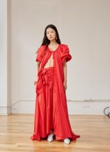 Rosie Assoulin: Languid silhouettes conjured up visions of long, lazy summer days at Rosie Assoulin where wide-legged trousers, oversized kaftans and long flowing dresses made a strong case for an effortless summer wardrobe.