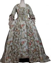 This silk dress with a floral chain motif and decorative trimmings (c. 1770) would have belonged to a reader to Marie Antoinette, possibly the young Sidonie Laborde, who remained in the service of the queen until her death. During their walks in the parks, places to see and be seen, ladies of the French aristocracy in the late 18th Century wore 'pastoral clothes' to create harmony with what was then perceived as the supreme refinement of the landscape.