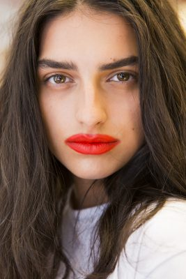Sies Marjan: Loose hair, brushed up eyebrows and messy smears of crimson lipstick was a fitting ode to undone glamour at Sies Marjan.