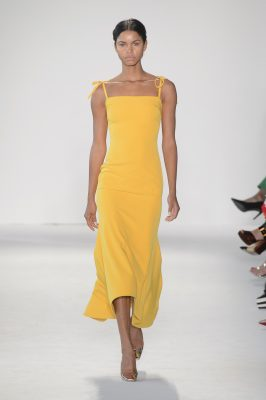 Christian Siriano: Christian Siriano sent out gown after gown in a parade of vibrant red carpet essentials. From zesty yellow and green citrus hues to magenta and gleaming floral brocades, the designer will be in high demand come awards season.