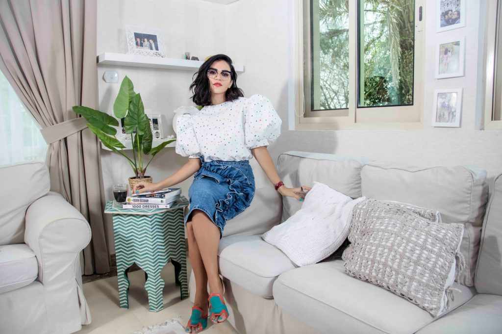 Mariam is photographed by Borna Ahadi in her home wearing top by Mrs Keepa, skirt stylist's own and shoes by Malone Souliers