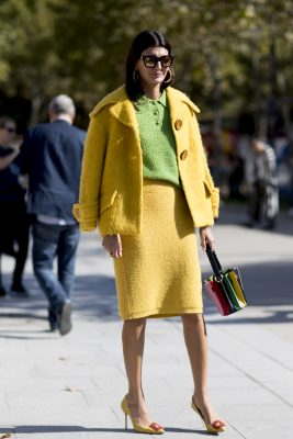 Green and Yellow: Lemon and lime shades are spot on for a striking and upbeat daytime look. These vivid tones can also be pared-back slightly by layering a crisp white shirt underneath a citrus-imbued coat or jumper.  For a more elevated approach experiment with rich emerald green garments and finish with an iridescent satin pump or opulent velvet mule.