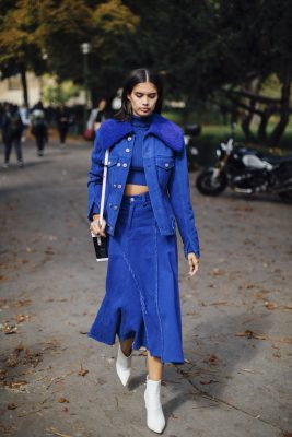 Blue: A full spectrum of blue outfits were seen in Paris this week, the most memorable of which consisted of loose and languid proportions. If wearing lighter, icier hues style with a hint of silver or if wearing cobalt or royal blue, pair with white ankle boots or sunglasses for a contemporary contrast.