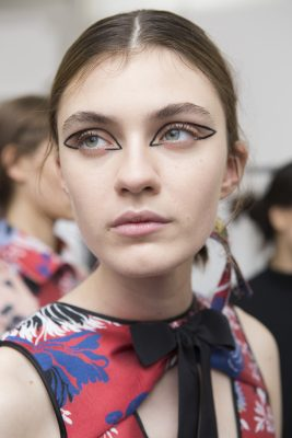 Rochas: Lucia Pierogi proved that less is more at Rochas by keeping faces make-up free and hand drawing on architectural sweeps of liquid eyeliner to frame the eye.