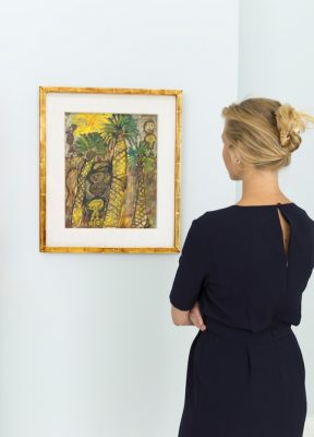 A woman admires one of the artworks in Sotherby's Dubai, DIFC.