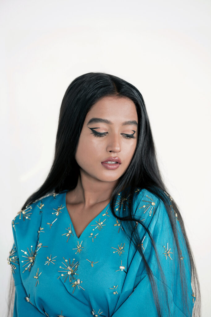 Rhea Jacobs wears a kaftan by Layeur