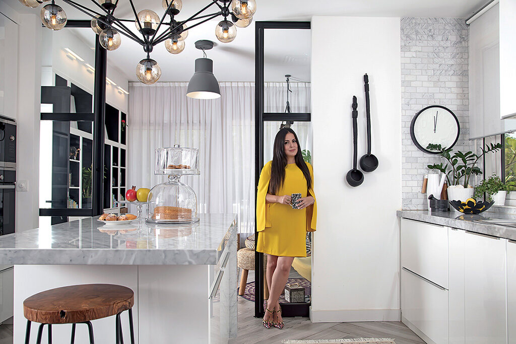 Brand specialist and interior designer Carla Conte in the sleek Italian marble kitchen at her Arabian Ranches home in Dubai