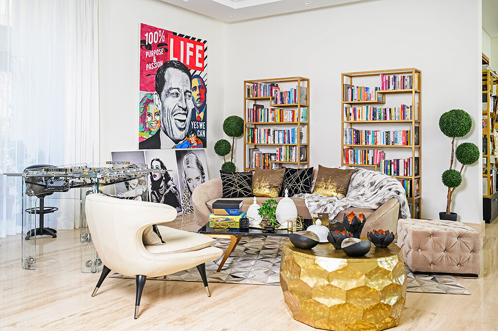 Pop art dominates the ground floor of Mona's home, with a specially commissioned piece of motivational speaker Tony Robbins, Oprah Winfrey and Barack Obama one of her most-treasured pieces.