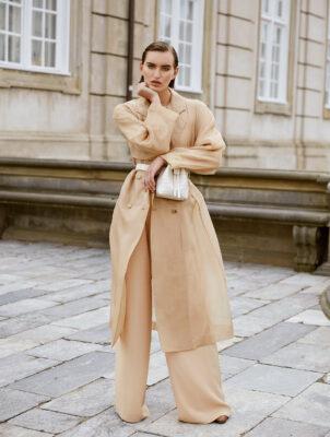 Trench coat, blouse, trousers and shoes, MAX MARA | Bag, NANUSHKA at MYTHERESA