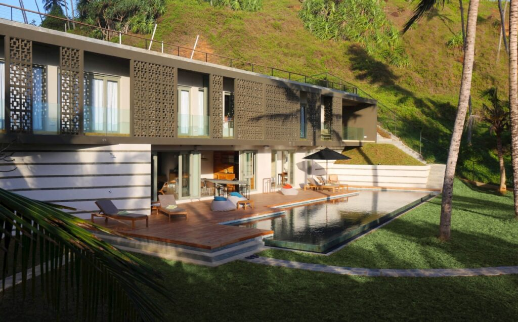 The open plan dining area opens out on to the infinity pool and garden