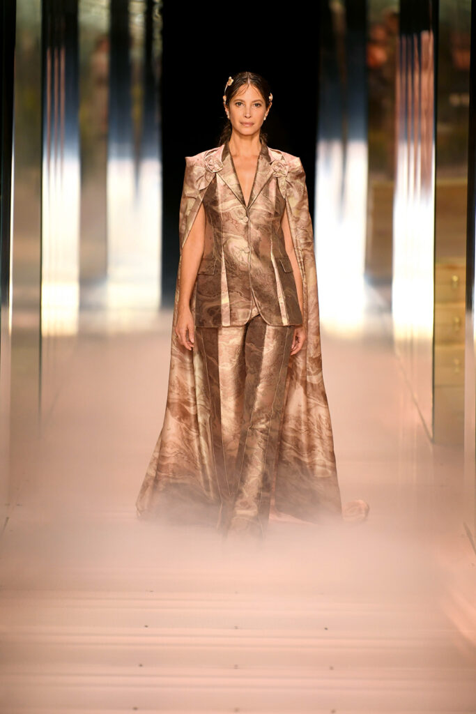 Models take to the runway in gold for Fendi
