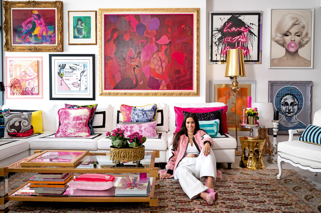 Interior designer Miri Najarian Khayat sits in her living room, surrounded by art and colourful furniture