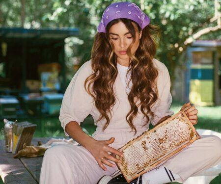 Negin Mirsalehi, Gisou founder, sits in her bee garden