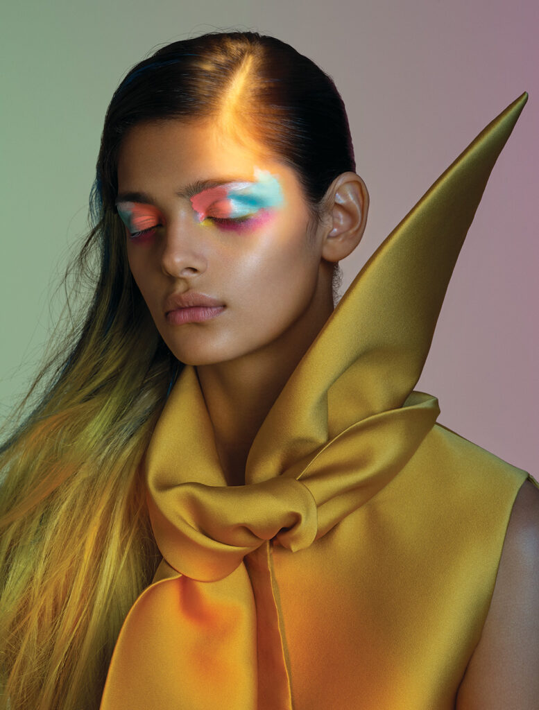 Colourful makeup like this multi-coloured eyeshadow look can boost your mood