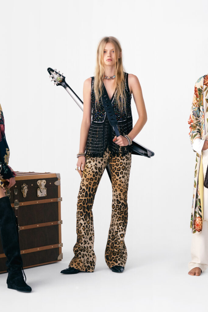 The Biggest Trends Of Pre-Fall 2021, Model wears leopard trousers, sequinned vest by Etro with a guitar slung over one shoulder