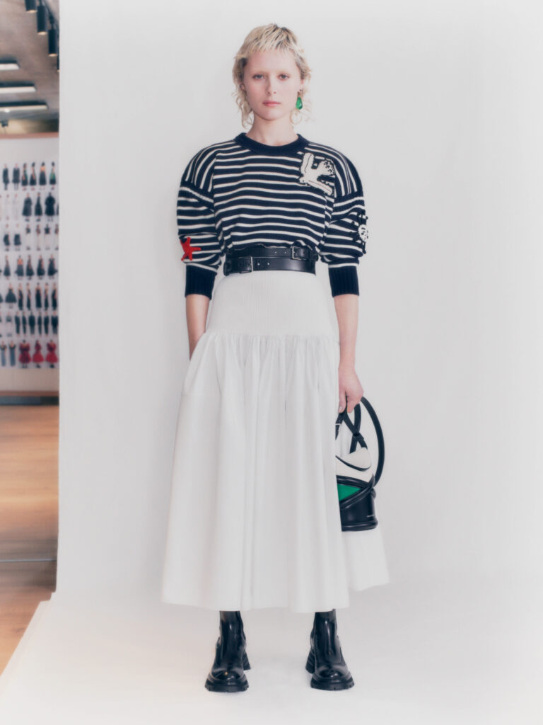 The Biggest Trends Of Pre-Fall 2021, Model wears high-waisted white skirt, knitted top from Alexander McQueen