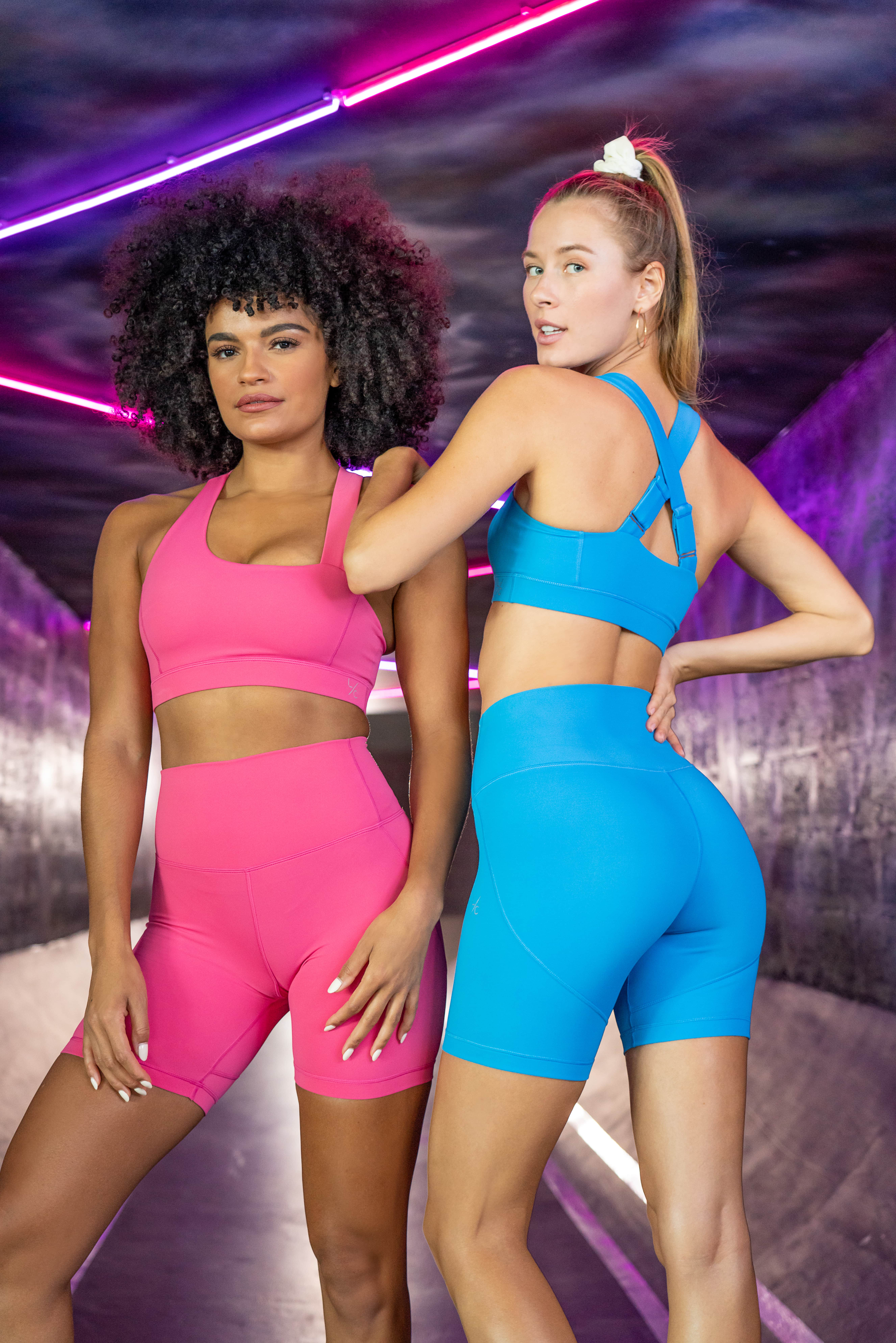 L'Couture Energy Will Get You Excited About Going To The Gym; Two women, one in pink and one in blue.