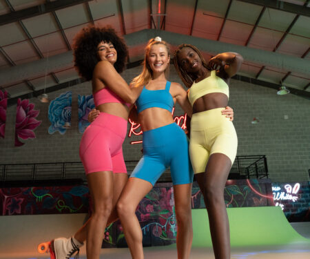 L'Couture Energy Will Get You Excited About Going To The Gym;Three women wear the set, standing together on roller skates