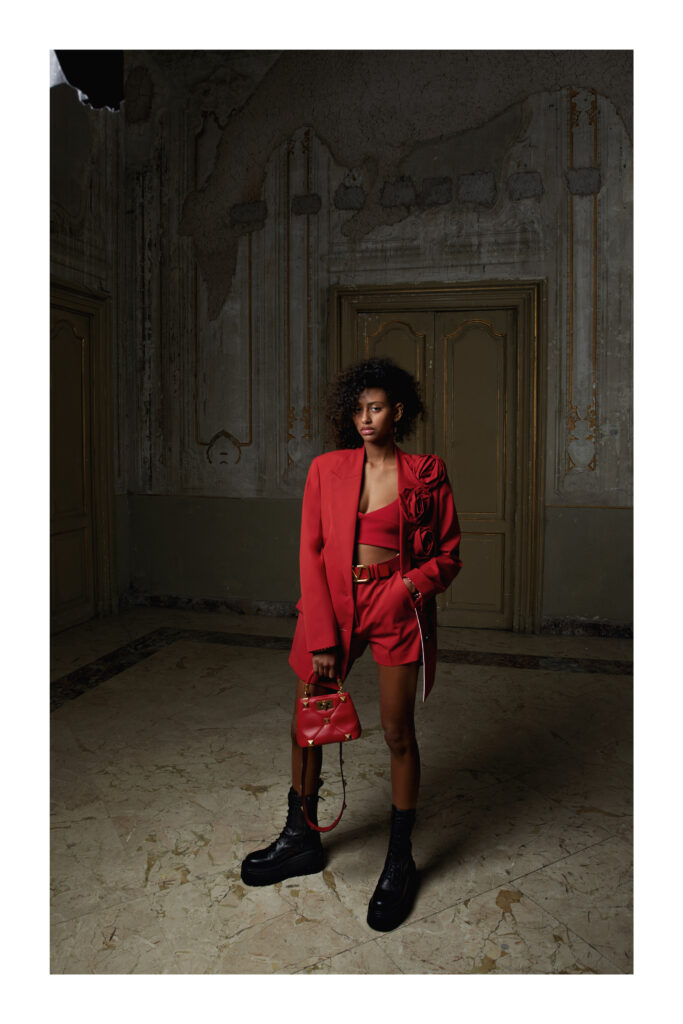 The Biggest Trends Of Pre-Fall 2021, Model wears Valentino red shorts, bralette and suit.