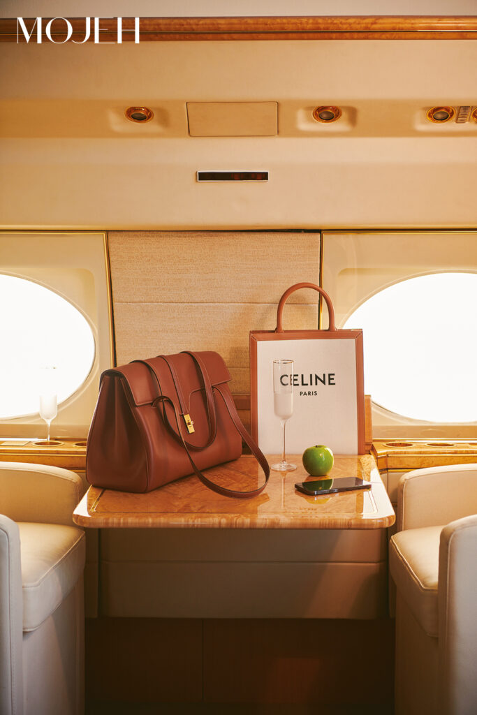 Travel Accessories You Can't Be Without This Holiday; Two Celine handbags on private jet table.