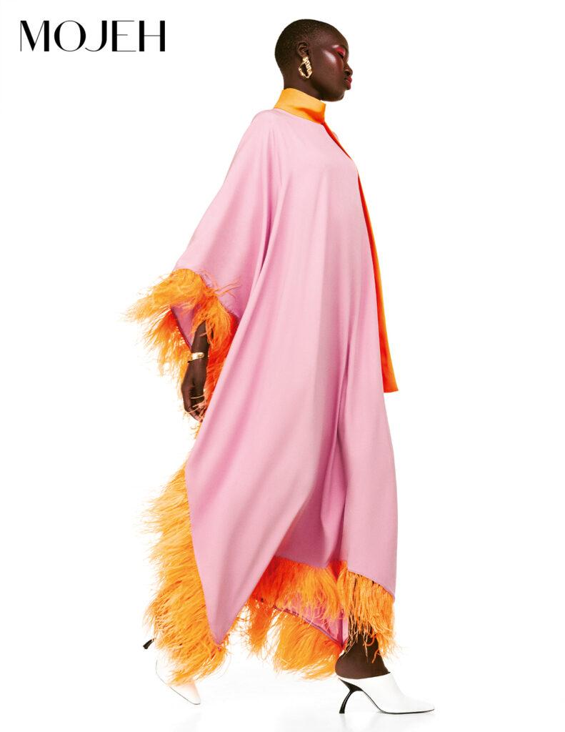 Model wears Taller Marmo pink and orange kaftan; orange makeup