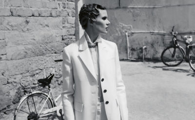 Christian Dior: Designer of Dreams exhibition comes to Doha. (Black and white photo of model in white Dior suit)